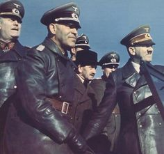 "Hitler with Jakob Grimminger, official bearer of the ""sacred"" Blutfahne at a NSDAP rally,"