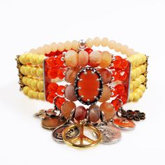 Hippie style bracelet  orange and yellow  charms by CatenaSieraden, €46.95
