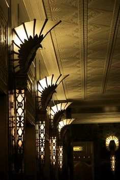 Art Deco lighting - Dee comments: Eerie, like I've been there before staring up at these lights but in another era. There is a feeling of people walking by me and talking in hushed voices, but I cannot make out the words. Glimpses of black beaded fringes and light golden satin of dresses. Flashes of jewels. I smell smoke from a cigar just put out, a bang, a scream, sudden commotion all around me, people rushing, sudden cold air hitting me, the banging of doors. What happened? Can't tell ...