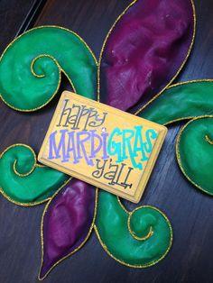 Fun & Funky Happy Mardi Gras Y'all Fleur De Lis door hanger wreath. $55.00, via Etsy.