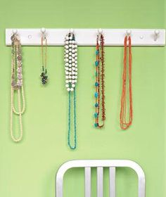 Use a Coat Rack Hang your best-loved (and most frequently worn) necklaces and bracelets within easy reach on a wall-mounted coat rack. Bonus: They'll stay tangle-free when not decorating your neck. Or mount corkboard—available in various sizes—on a wall and drape necklaces from straight pins.
