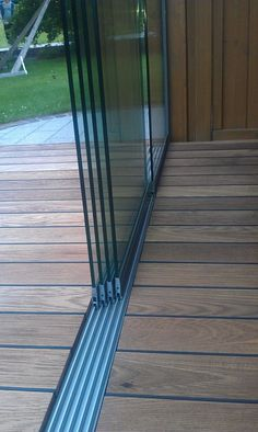 Sliding glass door - detail floor rail from Sunflex - Sliding glass doors Floor rail and other details of sliding walls you can now discover in our proje - Glass Balcony, Balcony Doors, Patio Roof, Backyard Patio, Glass Room, Glass Walls, Door Detail, Folding Doors, House Extensions