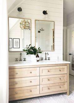 shiplap behind bathroom mirrors, shiplap bathroom vanity, light wood vanity, cement tile bathroom floor, geometric chandelier bathroom, square brass mirror with double sinks, wall sconce over mirror,