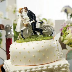 'A Kiss Above' Bicycle Bride and Groom Couple Figurine