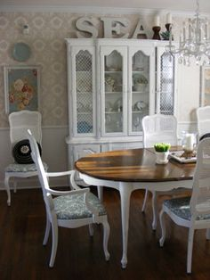 French Country Dining Room - Cane back chairs & hutch painted white.