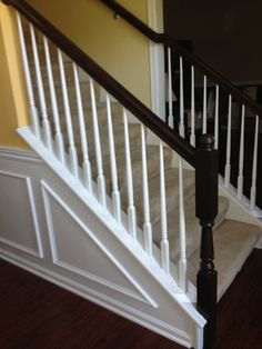 I used general finishes java gel stain and hand painted the railings - it used to be light oak.
