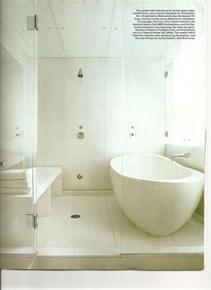 white bathroom, wet room combo and free standing tub