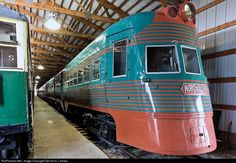 This St Louis Car built multiple unit is the No. 801-802 Electroliner, one of two sets built for the Chicago, North Shore & Milwaukee Railroad in 1941. These unique turquoise and salmon painted sets cemented the the North Shore's reputation as the fastest interurban in the USA. Their 86 mile run was from The Loop in downtown Chicago to downtown Milwaukee took a scheduled one hour and 58 minutes to complete. While that comes to an average of 45 MPH, the trains ran near 90MPH when they could.