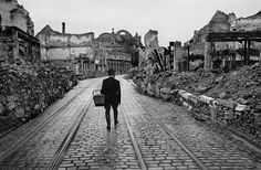 A man walks through a destroyed city in Germany looking for food, 1945, by Werner Bischof.