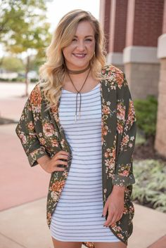 Floral light olive printed cuffed cardigan 90061. A best selling cardigan is now available in a print that is absolutely to die for! We promise these won't last! Great layered over a striped Piko top