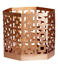 Hexagonal metal tealight holder with a perforated pattern. Diameter approx. 2 3/4 in., height 2 3/4 in.