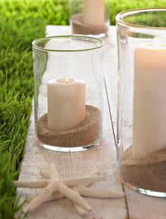 Sand, candles and starfish: For a glowing evening, fill hurricane vases with sand and fat white candles. Place the candle keepers in the center of your table, and after your meal, use them to line porch steps or define the edges of a patio or walkway.