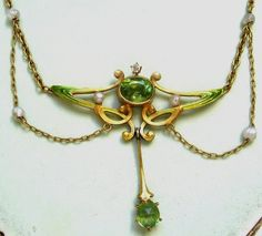 """Peridot Enamel Garland Necklace – KREMENTZ ?  It is pictured in Vivienne Becker's """"Art Nouveau Jewelry"""" on page 185. She describes it as having """"festoons of gold chain in the Edwardian manner, set with … peridots, and decorated with shaded satin enamel, c. 1900."""""""