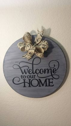 "Welcome to our Home 17"" Round Wood Sign with Burlap Bow and vinyl lettering by CreaTiveVinylDezign on Etsy https://www.etsy.com/listing/253783086/welcome-to-our-home-17-round-wood-sign"