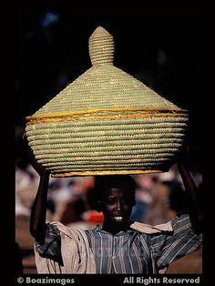 A big Injera basket on her head...  Bhar Dar  Ethiopia
