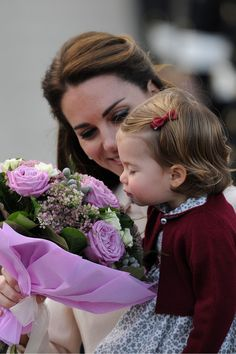 October 1, 2016: Princess Charlotte has a lesson in how to receive a bouquet of flowers.