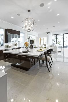 Fabulous! That's all it takes to describe this white modern kitchen with one MASSIVE kitchen island. It's beautiful.