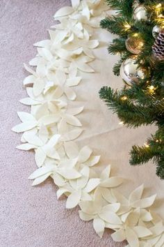 9 DIY Christmas tree skirts perfect for your Christmas tree, and many are no-sew DIYs. Styles include floral, ruched, burlap, neon, quilted and more...
