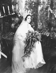 A bride with her bouquet on her wedding day (1934). | Florida Memory
