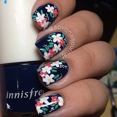 Beautiful red and white flowers on black polish nail art