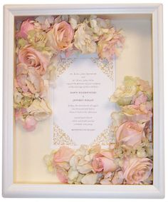 Dawn Dolan chose to decorate her invitaion with a selection of her wedding bouquet in a 10x12 white shadow box. www.jenniferannedesigns.com