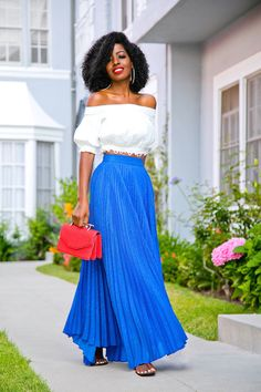 Style Pantry White off the shoulder shirt Blue Accordion Skirt Black Shoes Red Purse Silver Earrings