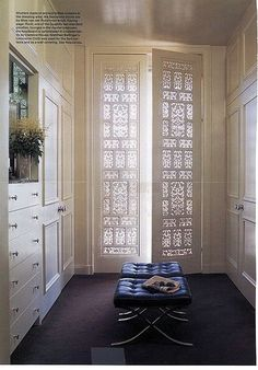 nice use of an indian wood screen - converted to french doors.