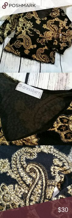 Dress Barn black and gold top Black and gold dress Barn top, great for evening, office or every day. It has a paisley design, with cuffs that flare at the end of the sleeves. Dress Barn Tops Blouses