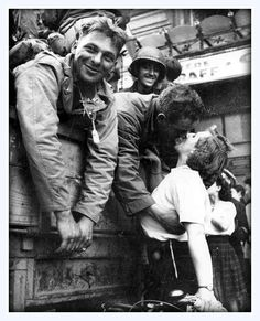 "#1940s An American GI of the US 4th Infantry Division ""Steadfast and Loyal"", also called ""Iron Horse"", receives a #kiss in gratitude for the liberation of Paris during World #War II. August 25, 1944"