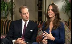 Kate showcases the oval 12-carat Ceylon sapphire surrounded by a cluster of 14 solitaire d...