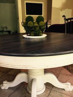 Refinished Clawfoot Table sanded top restained in mix of General Finishes 1/2 Java 1/2 Antique Walnut. Light gray paint wash applied. Waxed. Bottom chalk painted and waxed.