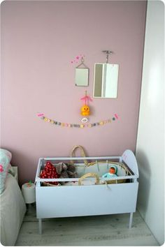 Gorgeous little girl room. Simple crib turned baby doll home
