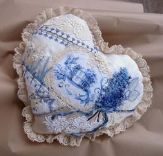A most delicate and beautiful Delft-style heart pillow! I might just try to make one of these myself, as I seriously doubt that I can afford one of these. I do have the manual dexterity, supplies and sewing ability, so maybe I'll just do that!