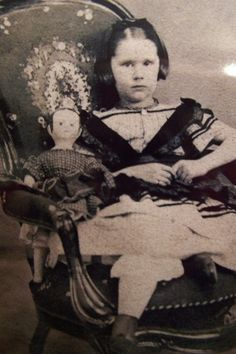Vintage photo of young girl with Izannah Walker doll, circa 1880.