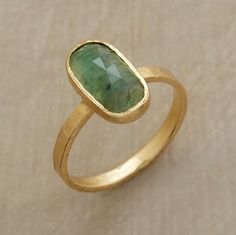Emerald Pool Ring  Pools of light reveal the depths of a faceted emerald warmed by matte, hammered 18kt gold. Handmade in USA by Jennifer Dawes. Please allow 6 to 8 weeks for delivery. Whole sizes 5 to 9.  Read Our Product Story     Be the first to write a review  #56634 Emerald Pool Ring  $2,200.00