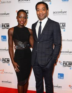 """…but also oozes goddess in this sleek, formfitting little black dress. 