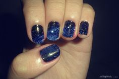paint your nails black, then put blue on the tip and then take a toothpick and put white dots on your nail!