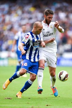 Sergio Ramos competes for the ball with Laure Sanabria during the La Liga match between RC Deportivo La Coruña and Real Madrid CF at Riazor Stadium on September 20, 2014 in La Coruña, Spain.