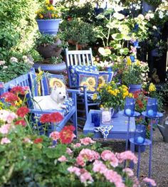 Tuscan color scheme carries into the garden, cobalt blue, touches of yellow, sunflowers, bright, cheery and a calming haven.