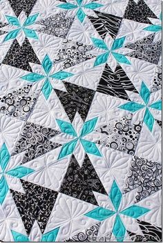 Used Rapid Fire's Hunter Star ruler.  TamarackShack's lovely quilting!