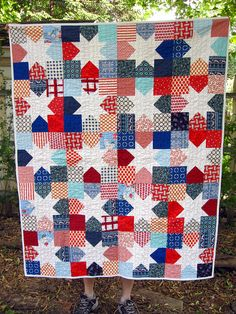 I love bright colours with white but usually there is too much white for a child's quilt. This would hide some of the stains!