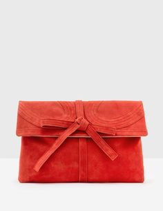 This clutch bag is crafted from soft suede, with a cotton sateen lining, for a luxuriously smart finish. It's large enough to hold all your essentials, but has internal pockets so you don't spend time scrabbling about in search of elusive keys.