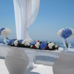 Hydrangeas are the perfect choice for a summer wedding. Here the ceremony table decorated @Dana Curtis Villas Santorini