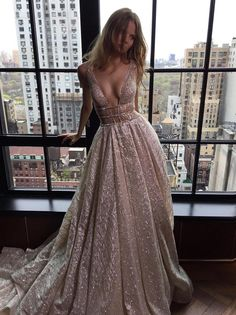 The rose gold sparkly sequin dress featuring long formal evening prom gown,  with plunging V-neck and ...