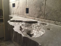 incredible custom concrete countertop with topography lines
