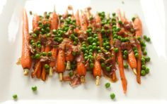 The classic combo of carrots and peas gets a delicious update with the addition of pancetta, fresh herbs and red wine vinegar.
