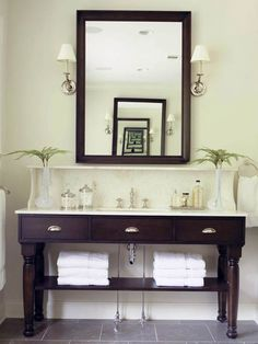 This furniture-style vanity has open storage for towels and other bathroom necessities. More open vanities: http://www.bhg.com/bathroom/vanities/open-vanity-bath-storage/?socsrc=bhgpin052212#page=1