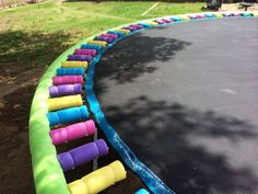Zip Tie Hacks That'll Make Your Life Easier Attach pool noodles to a trampoline for safety.Attach pool noodles to a trampoline for safety. Trampoline Springs, Backyard Trampoline, Backyard Playground, Backyard For Kids, Trampoline Spring Cover, Trampoline Safety, In Ground Trampoline, Playground Ideas, Ideas Party