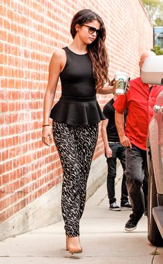 Selena Gomez dons sassy printed pants and a pretty peplum top when hitting a recording studio in Los Angeles.