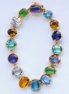 Tourmaline, peridot, sapphire, amethyst, citrine, aquamarine, zircon and crimped-bezel gold bracelet